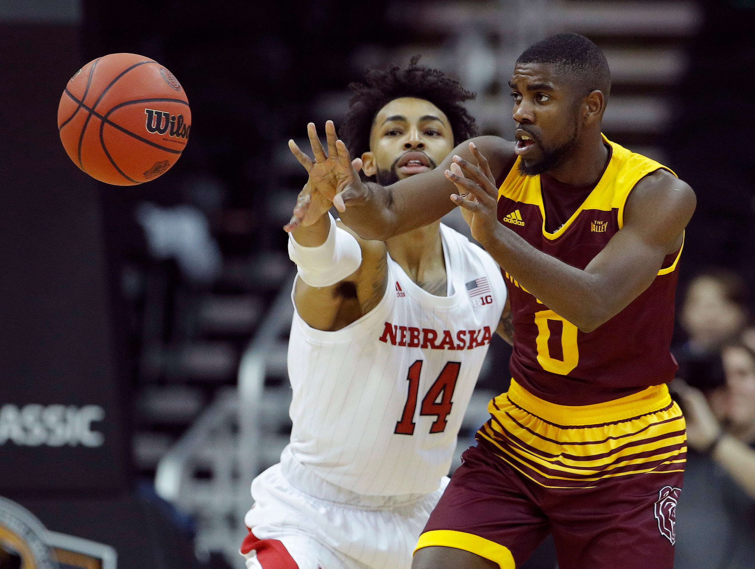 Missouri State's Josh Webster (0) passes under pressure from Nebraska's Isaac Copeland Jr. (14) during the first half of an NCAA college basketball game Monday, Nov. 19, 2018, in Kansas City, Mo. (AP Photo/Charlie Riedel)