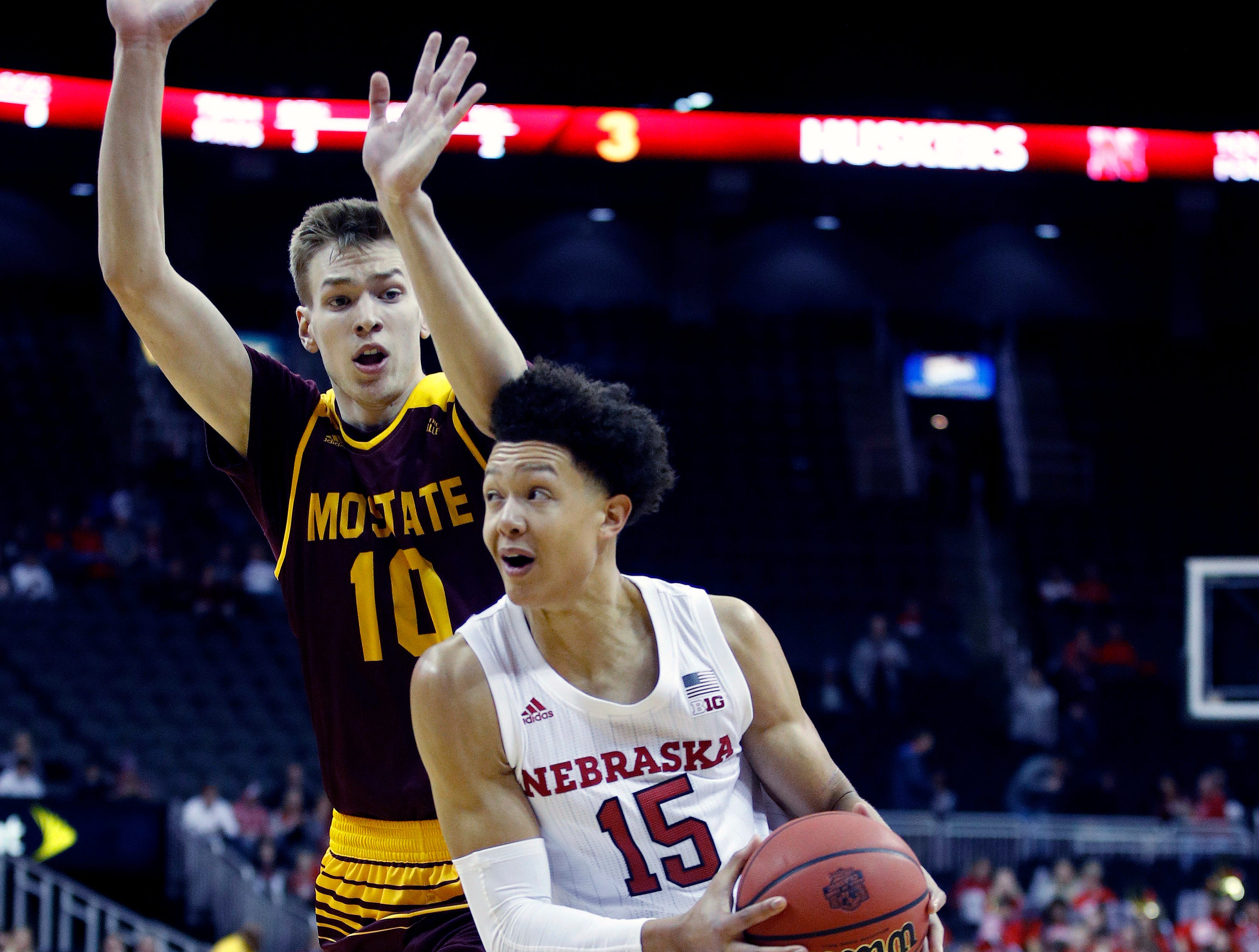 Nebraska's Isaiah Roby (15) goes up for a shot under pressure from Missouri State's Szymon Wojcik (10) during the first half of an NCAA college basketball game Monday, Nov. 19, 2018, in Kansas City, Mo. (AP Photo/Charlie Riedel)