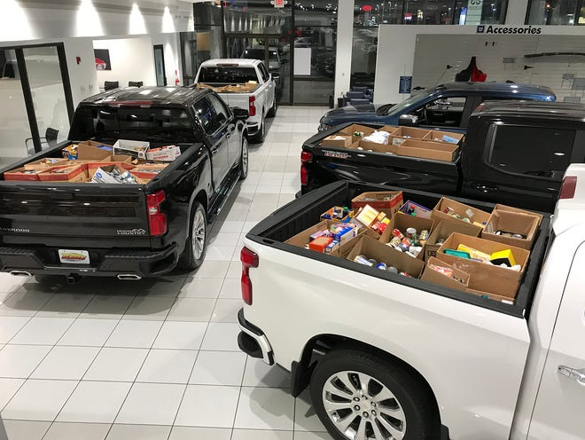 Ten Chevy pickups at Reliable Chevrolet were filled to the brim with boxes of nonperishable food items headed for Grand Oaks Mission Center. The food was donated by area drivers, who received a complimentary oil change in exchange for their generosity.