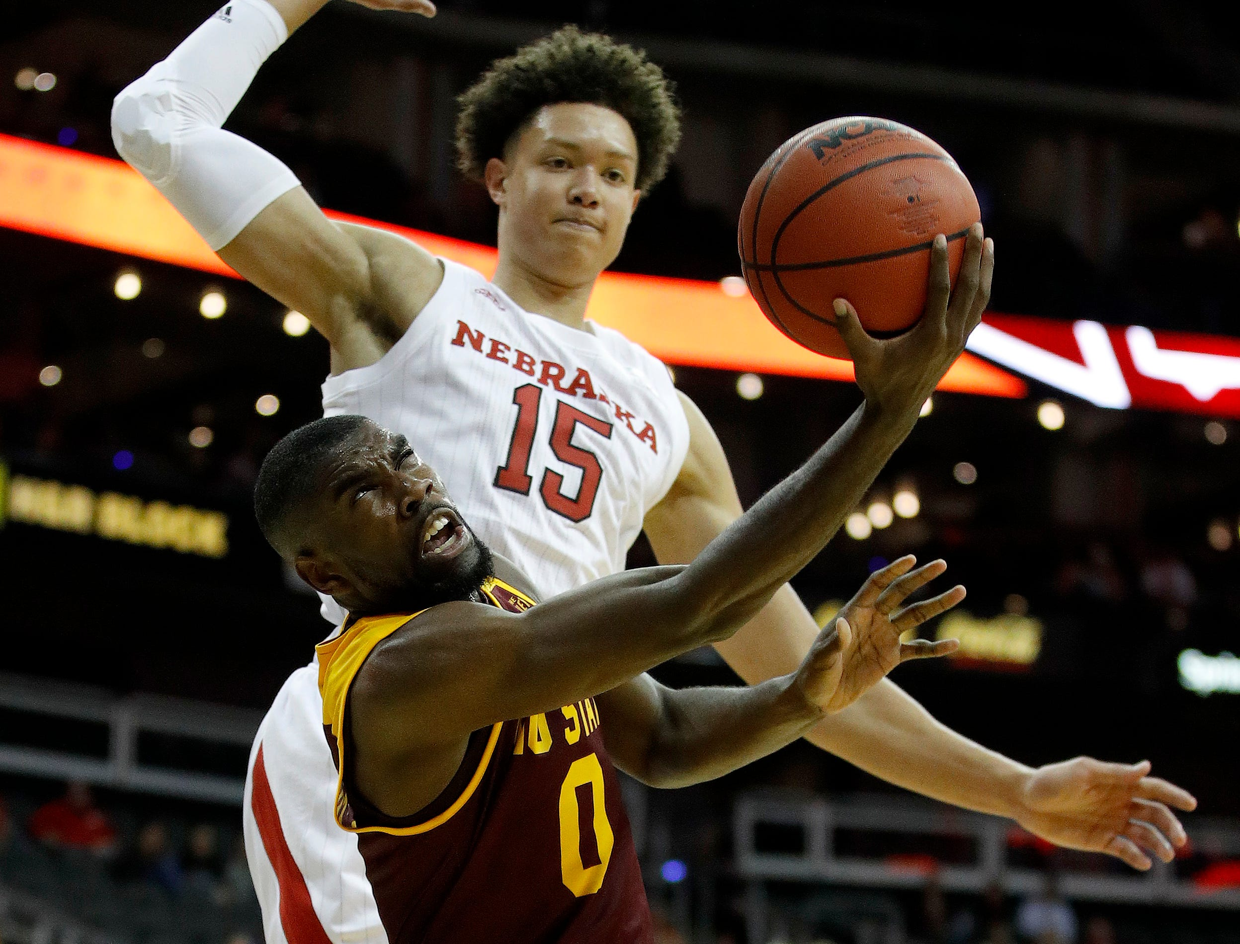 Missouri State's Josh Webster (0) shoots under pressure from Nebraska's Isaiah Roby (15) during the second half of an NCAA college basketball game Monday, Nov. 19, 2018, in Kansas City, Mo. Nebraska won the game 85-62. (AP Photo/Charlie Riedel)