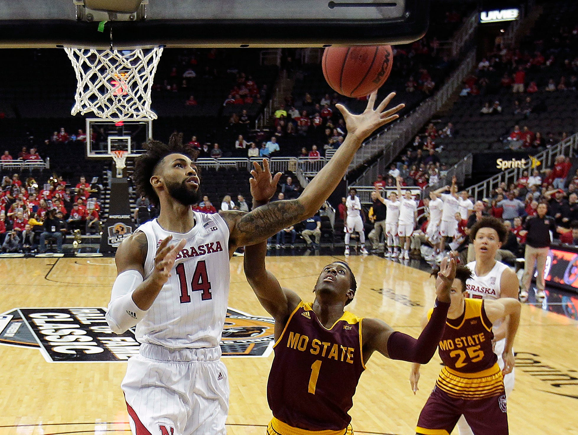 Nebraska's Isaac Copeland Jr. (14) gets past Missouri State's Keandre Cook (1) to put up a shot during the first half of an NCAA college basketball game Monday, Nov. 19, 2018, in Kansas City, Mo. (AP Photo/Charlie Riedel)