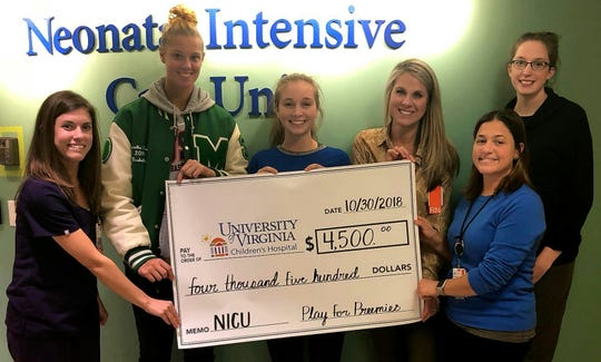 Western Albemarle High School senior Elisabeth Coffman, the 2018 Jefferson District Player of the Year, and William Monroe High School senior Sam Brunelle, the 2018 Class 3 player of the year, present a donation to the University of Virginia Children's Hospital's Neonatal Intensive Care Unit (NICU) from funds raised through the 2018 Play for Preemies event.  Both players and their teams will play again this season in the third annual Play For Preemies Showcase on Jan. 5, 2019 at Western Albemarle High School.