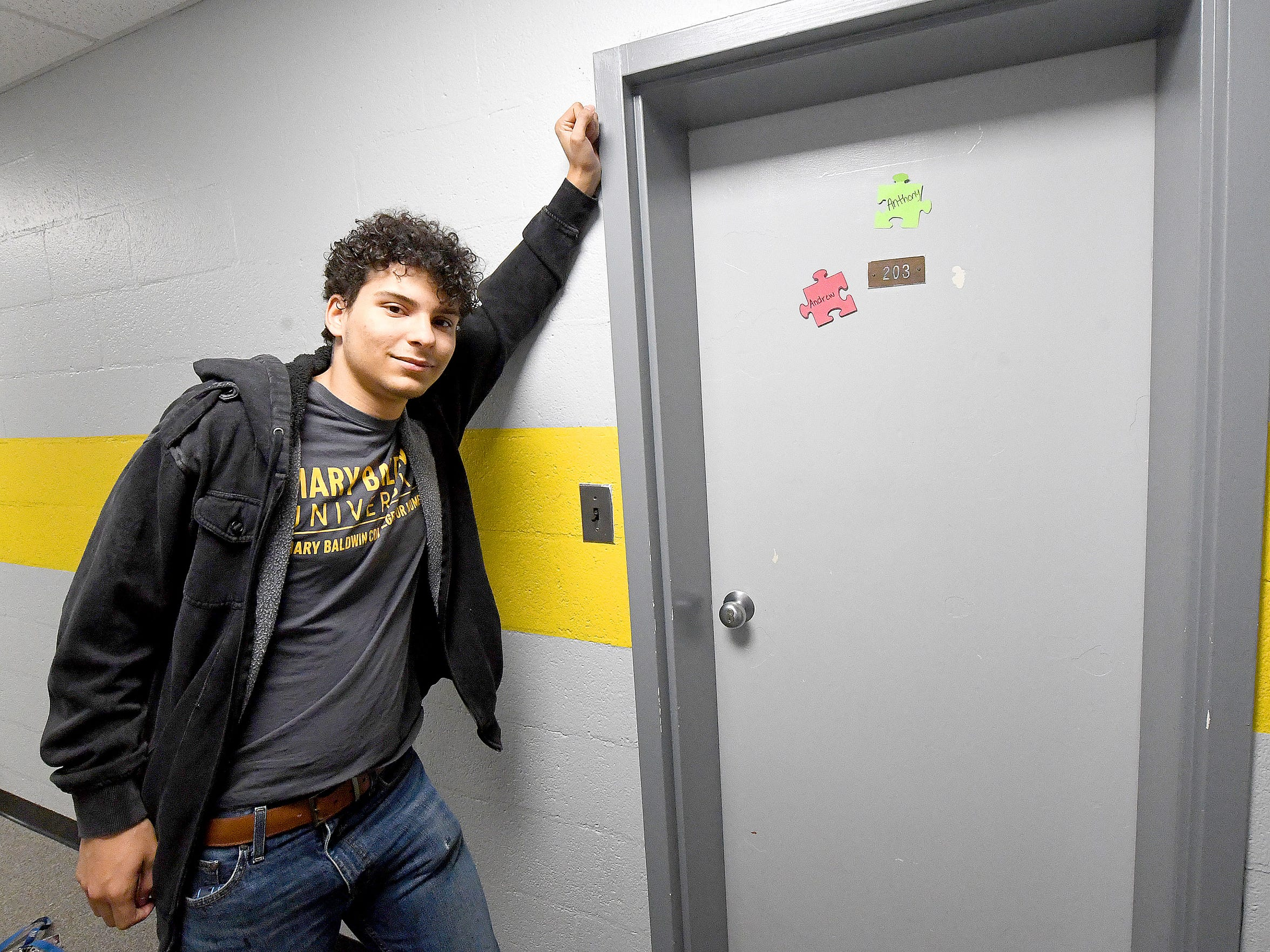 Logan Davenport, now a junior at Mary Baldwin University, stands in the hallway outside his old dorm room in Tullidge Residence Hall.