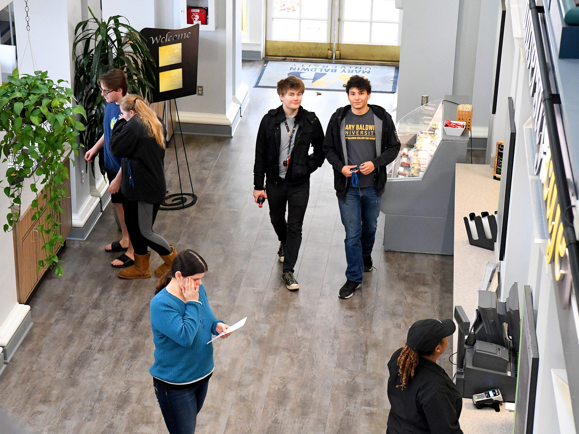 """Being one of the first males at Mary Baldwin University """"definitely gave me more respect just all around, and more understanding of where other people are coming from,"""" says Dominic Walker. He and Logan Davenport arrive at University Cafe on campus on Tuesday, Nov. 20, 2018."""