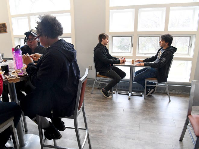 Juniors Dominic Walker and Logan Davenport of Mary Baldwin University share a table and conversation at University Cafe on campus on Tuesday, Nov. 20, 2018. Both were among the first eight males to live on campus.