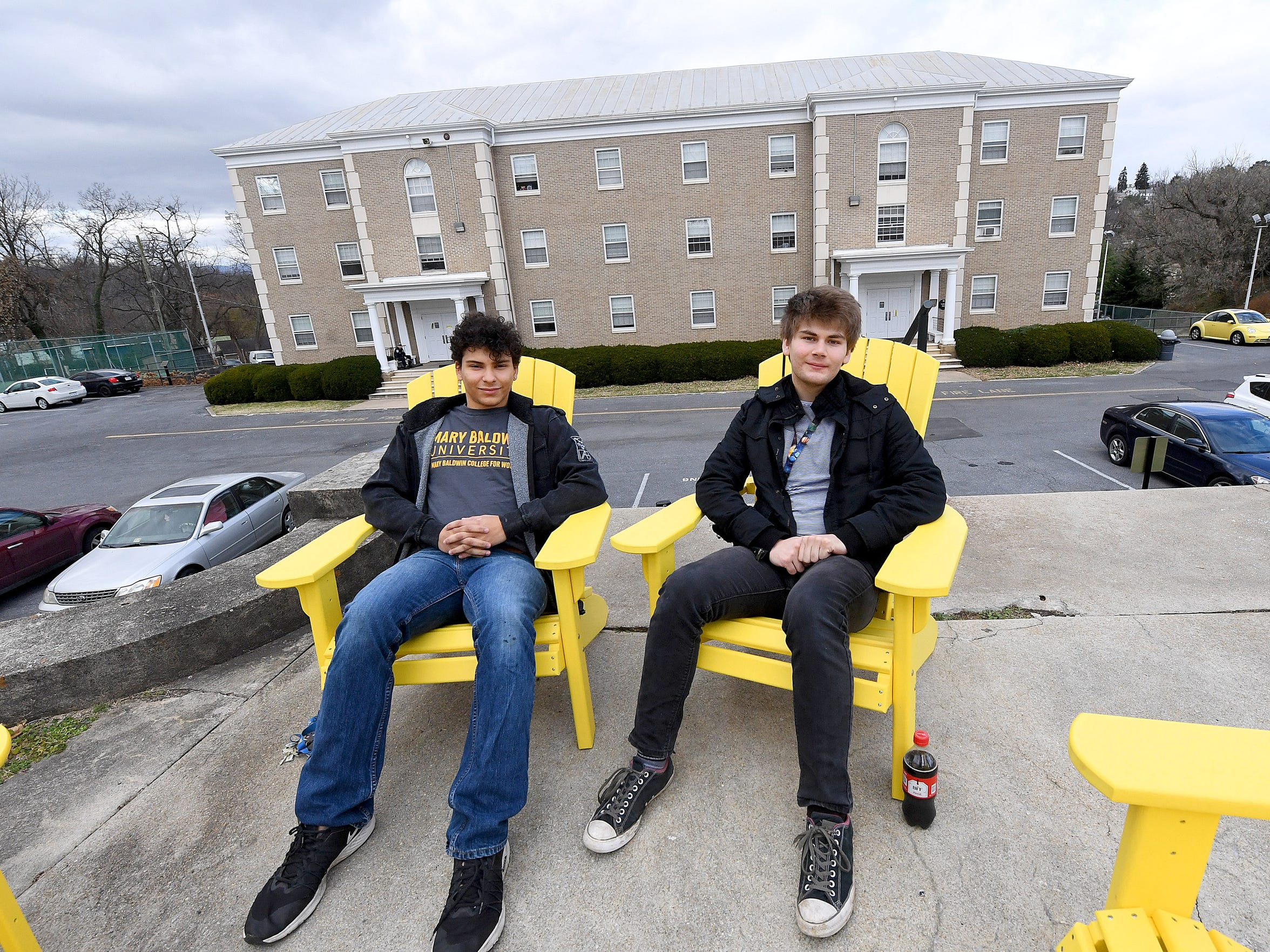 Juniors Logan Davenport and Dominic Walker of Mary Baldwin University sit in front of Tullidge Residence Hall. Both live off campus this year.