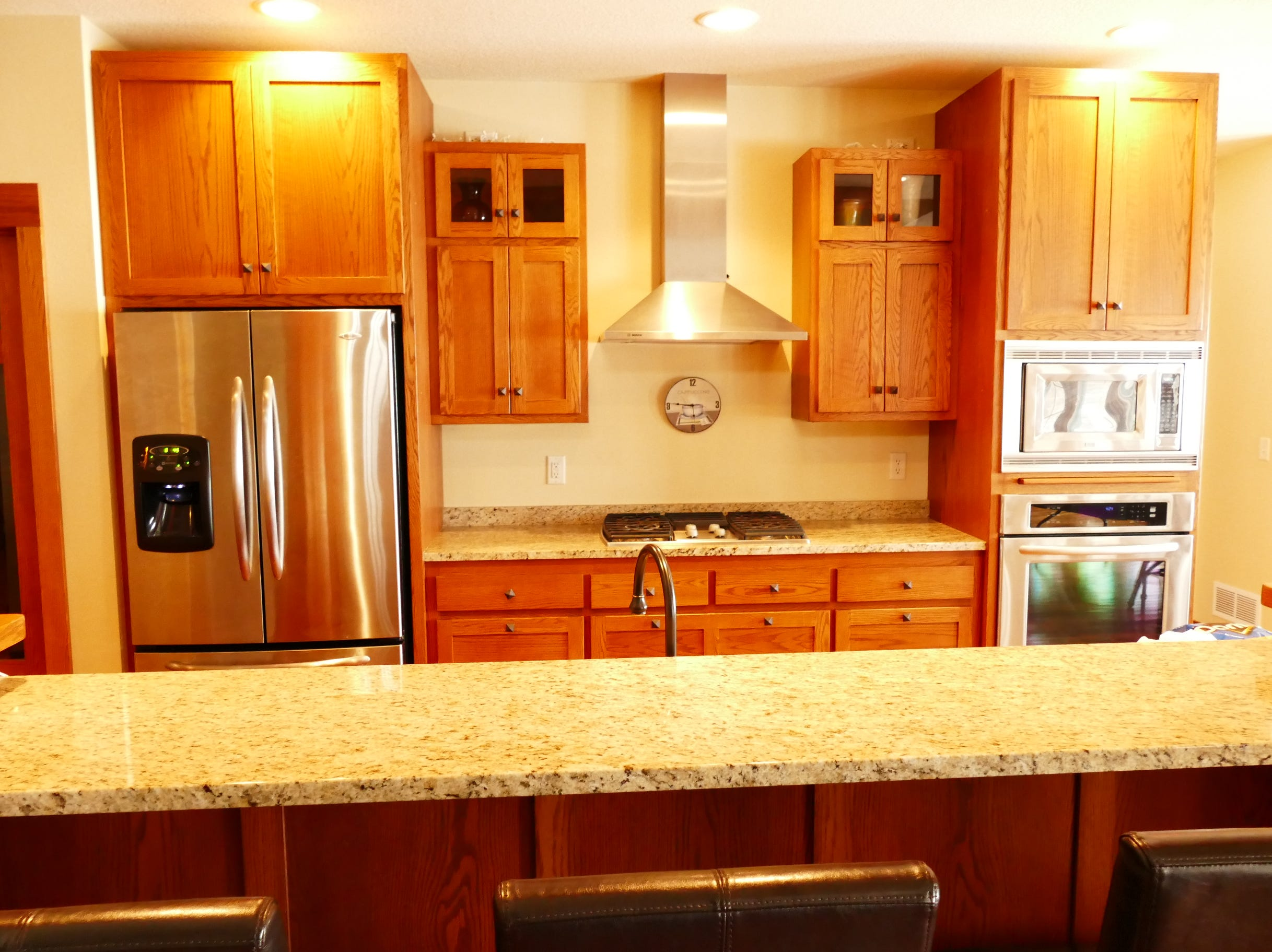 The kitchen includes a built-in coffee bar/buffet area as well as a large pantry and plenty of cupboard storage.