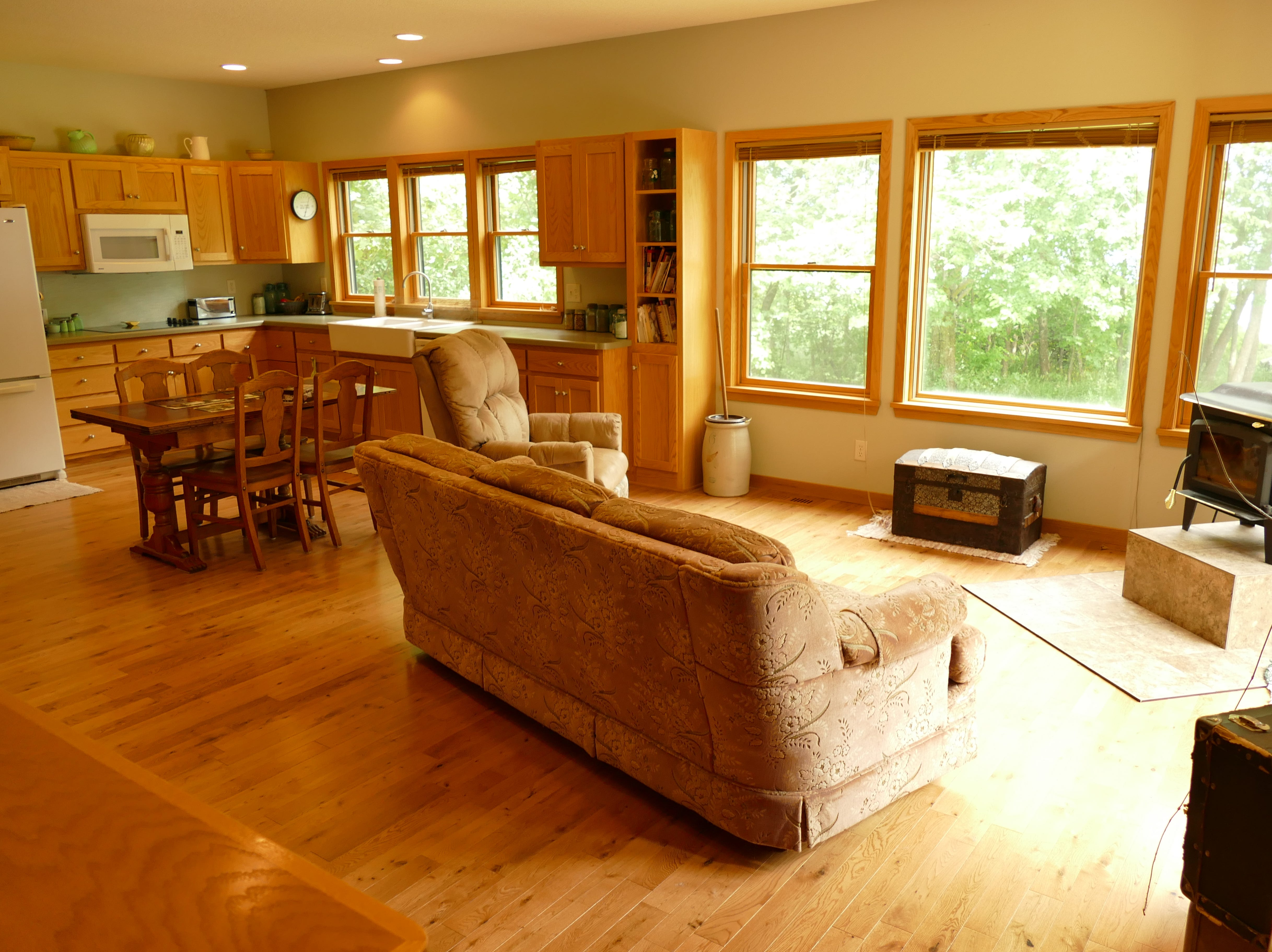 Theattached mother-in-law home is complete with a large kitchen and walk-in pantry, dining room and great room overlooking the lake