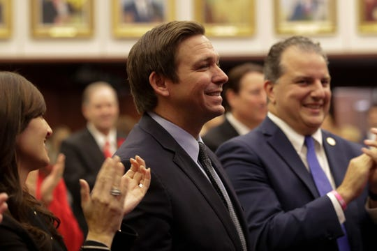 Governor Ron DeSantis stands as he is recognized during the Senate organizational session at the Florida State Capitol Tuesday, Nov. 20, 2018.