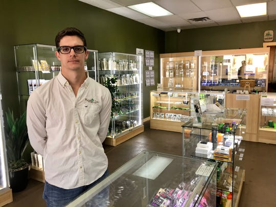 Alex Petrick, distribution manager for Natural Life on West Pensacola Street.