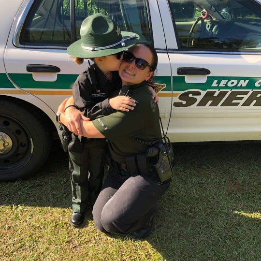 Jessalyn Younger-Gaskins, 5, stands with Leon County Sheriff's Deputy Cecelia Crego. Jessalyn dressed up as the deputy for Halloween.