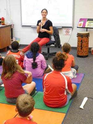 Bethany Bennitt, music teacher at Conely Elementary School, introduces her students to the recorder.