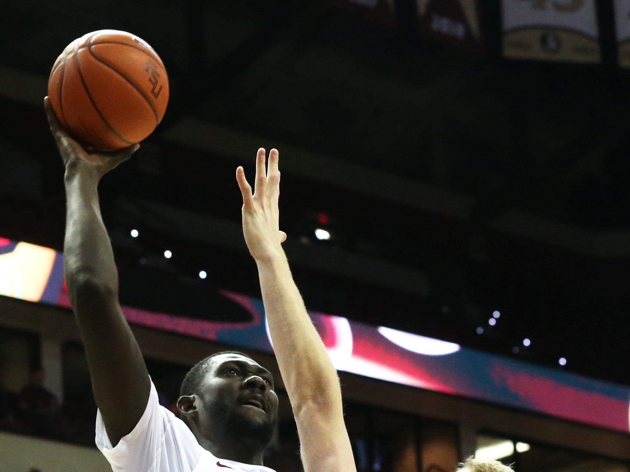 Florida State Seminoles center Christ Koumadje (21) sneaks in a shot over his defender, Canisius Golden Griffins forward Scott Hitchon (21) as the Florida State Seminoles host the Canisius Golden Griffins for basketball in the Tucker Civic Center, Monday, Nov. 19, 2018.