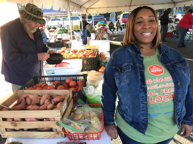 Leann Watts-Williams, the city's southside neighborhood services coordinator, right, shown at a previous Southside Farmer's Market. A special Earth Day market will be held from 2-6 p.m. Thursday outside the Walker-Ford Community Center.