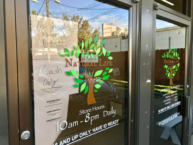 Tallahassee police confiscated 10 pounds of hemp flower from the Natural Life store on Tuesday. A sign on the door signals to customers that the product is no longer available.
