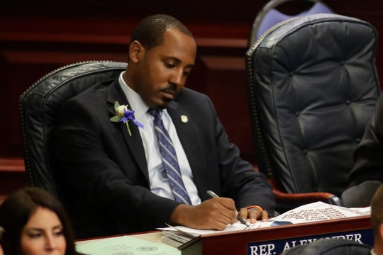 Rep. Ramon Alexander (D-Tallahassee) sits at his desk during the House of Representatives organizational session at the Florida State Capitol Tuesday, Nov. 20, 2018.