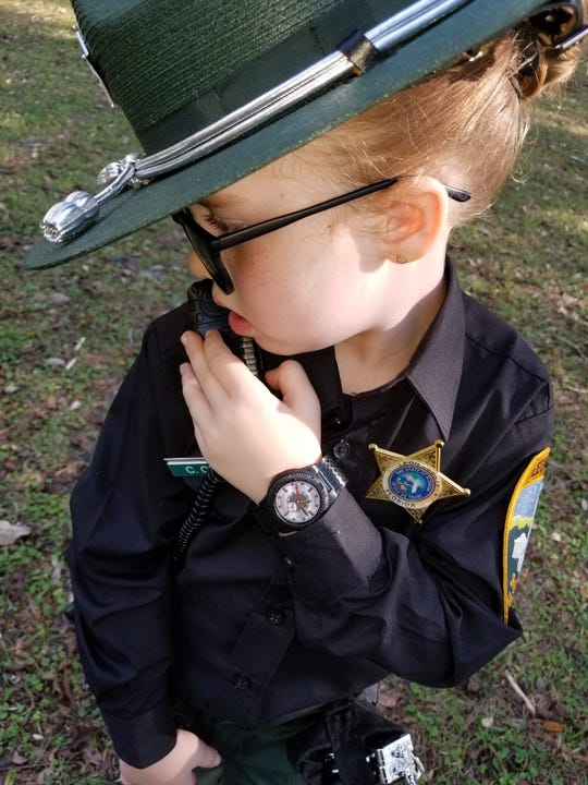 Jessalyn Younger-Gaskins, 5, poses as her superhero Leon County Sheriff's Deputy Cecelia Crego on Halloween. Crego let Jessalyn wear her hat and name badge to complete the costume.
