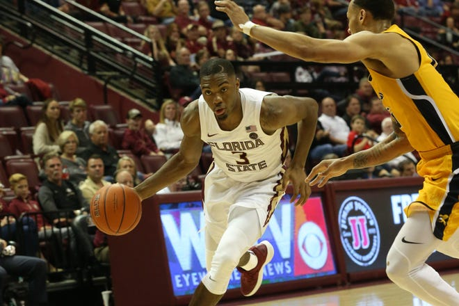Florida State Seminoles guard Trent Forrest (3) drives the ball in for a layup as the Florida State Seminoles host the Canisius Golden Griffins for basketball in the Tucker Civic Center, Monday, Nov. 19, 2018.