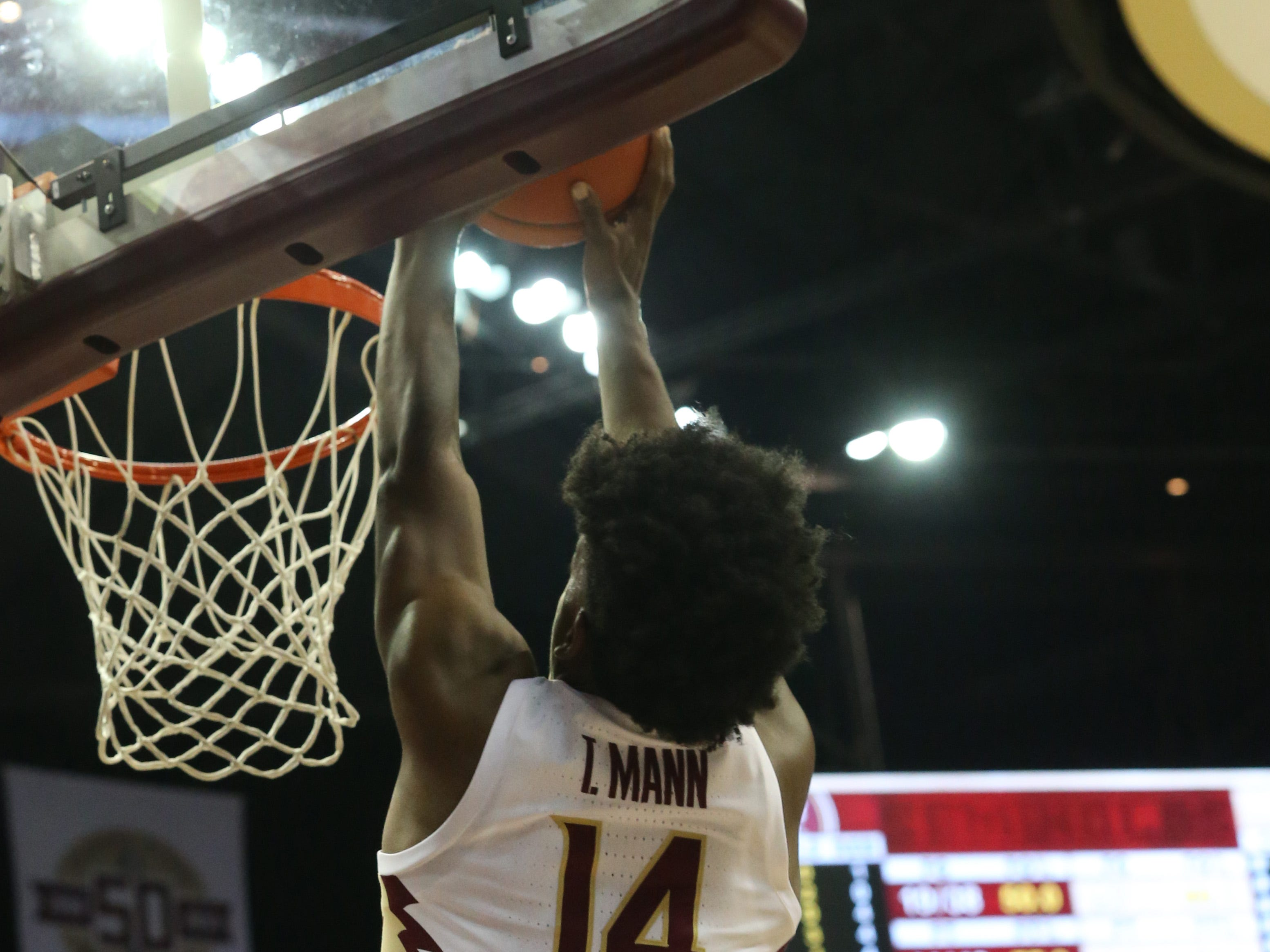 Florida State Seminoles guard Terance Mann (14) dunks on Canisius defense as the Florida State Seminoles host the Canisius Golden Griffins for basketball in the Tucker Civic Center, Monday, Nov. 19, 2018.