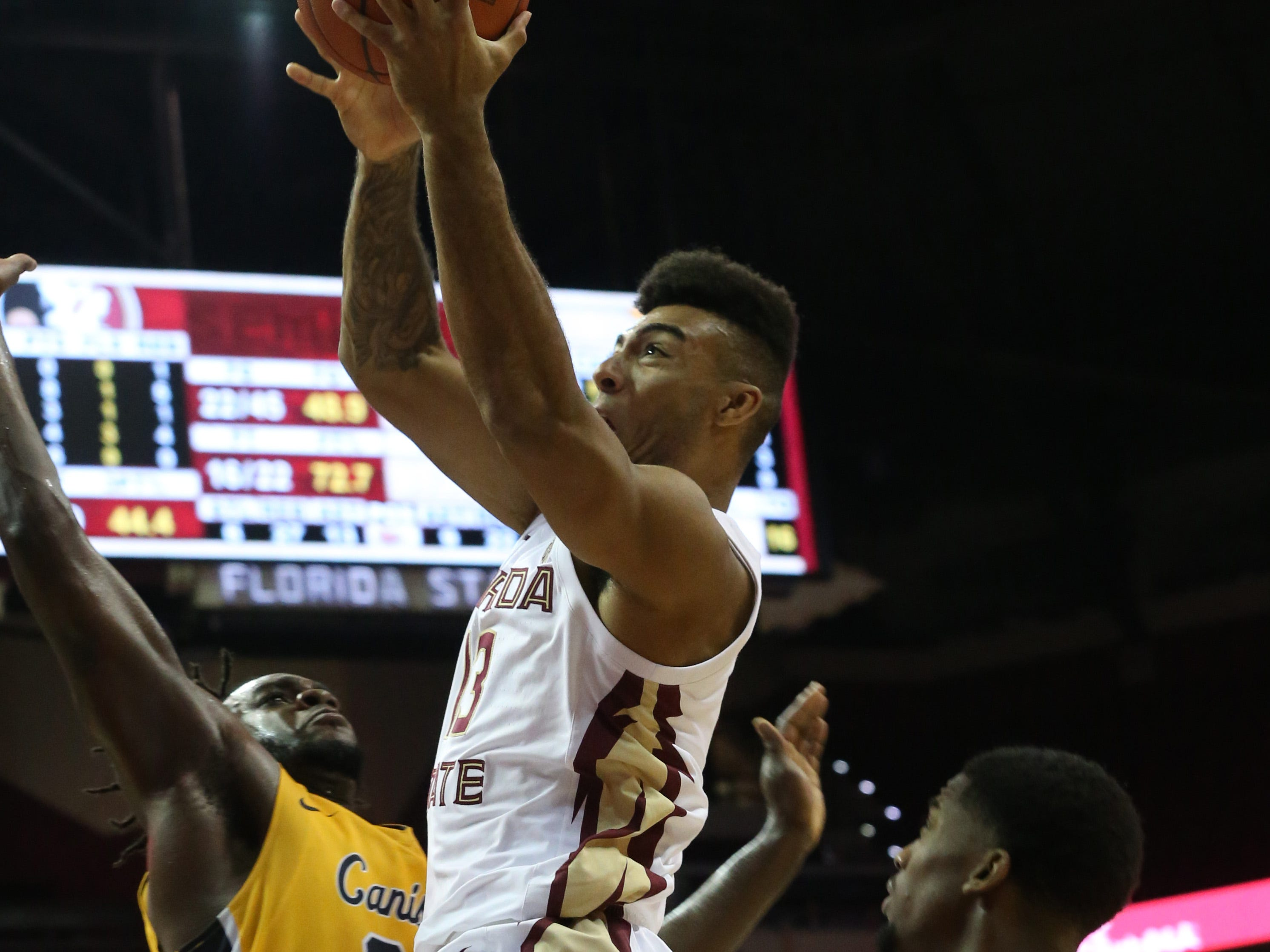 Florida State Seminoles guard Anthony Polite (13) drives the ball in for a layup as the Florida State Seminoles host the Canisius Golden Griffins for basketball in the Tucker Civic Center, Monday, Nov. 19, 2018.