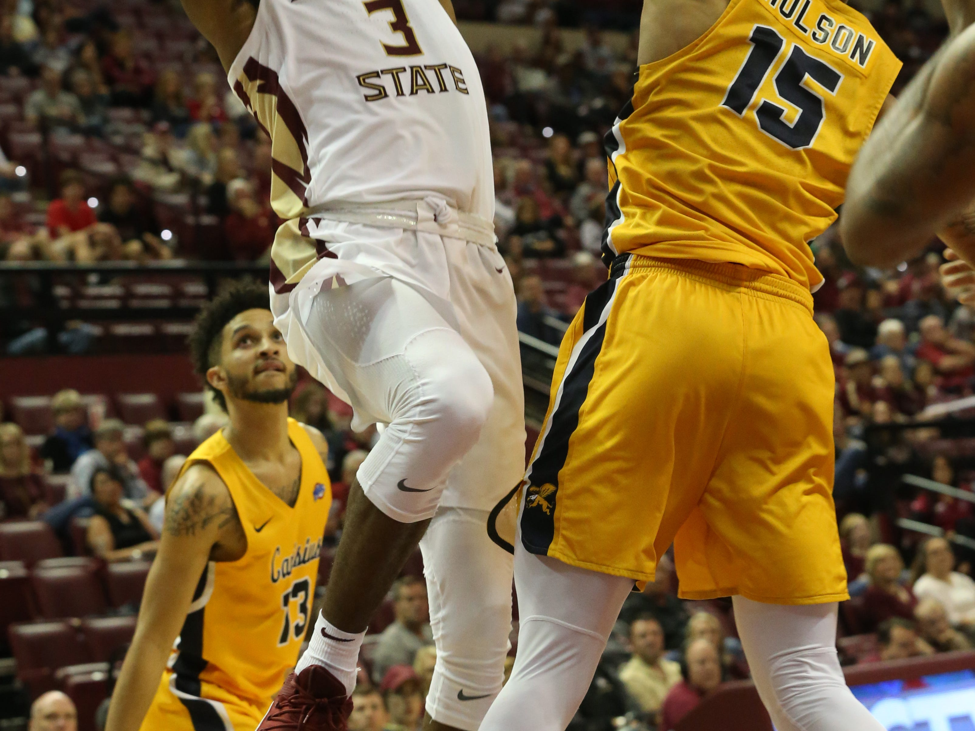 Florida State Seminoles guard Trent Forrest (3) shoots over Canisius Golden Griffins guard Takal Molson (15) as the Florida State Seminoles host the Canisius Golden Griffins for basketball in the Tucker Civic Center, Monday, Nov. 19, 2018.