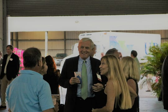 Don Drinkard, center, Capital Campaign Cabinet chair, speaks with Amy Patterson, UP Board member, and guests at United Against Poverty's Lifting Lives Out of Poverty Capital Campaign kick-off for Phase II.