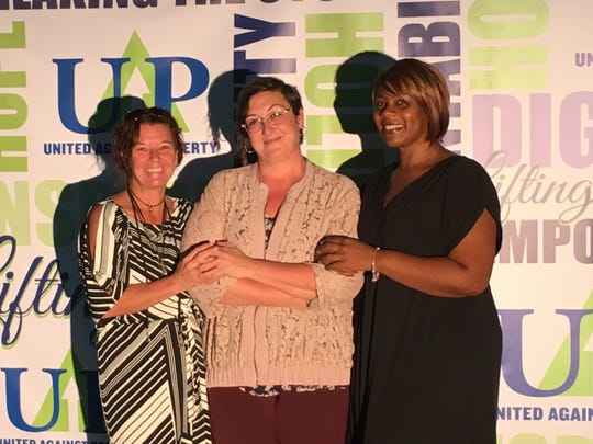 STEP graduate Stacy Thompson, left, with Jane McNulty Snead, Capital Campaign coordinator, and volunteer Nikkia Bagley.