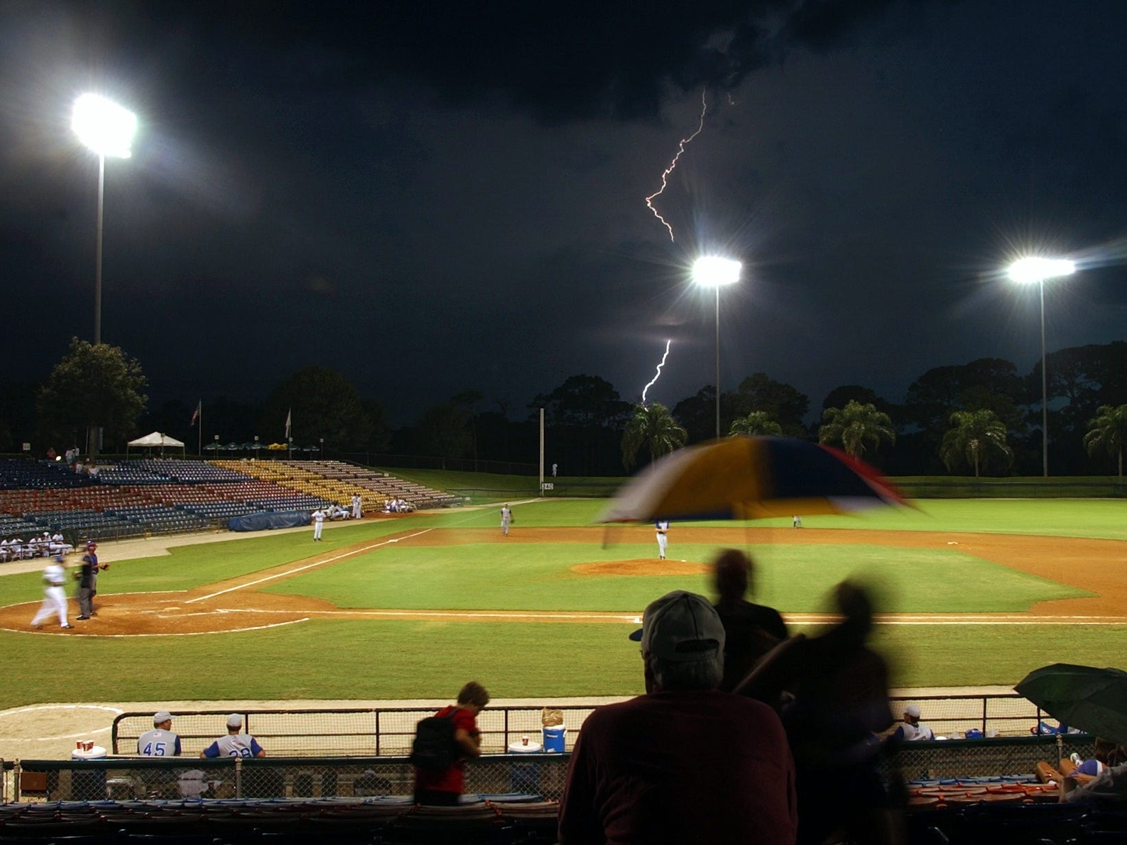 August 1, 2002 - Some brief bursts of lightning caused spectators to run for cover, but the Vero Beach Dodgers' home game against the Daytona Cubs kept going right on going through the small storm that popped up and caused a little bit of rain in Dodgertown. The Vero Beach Dodgers lost the game, 6-3.
