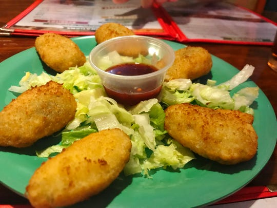 Pueblo Viejo's Jalapeno Poppers are spicy, hot jalapeno chiles stuffed with cheese, then breaded and fried.