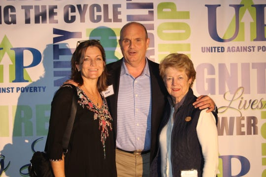 Kelly McCrystal, left, John Moore and Anne Marie McCrystal at United Against Poverty's Lifting Lives Out of Poverty Capital Campaign kick-off for Phase II.