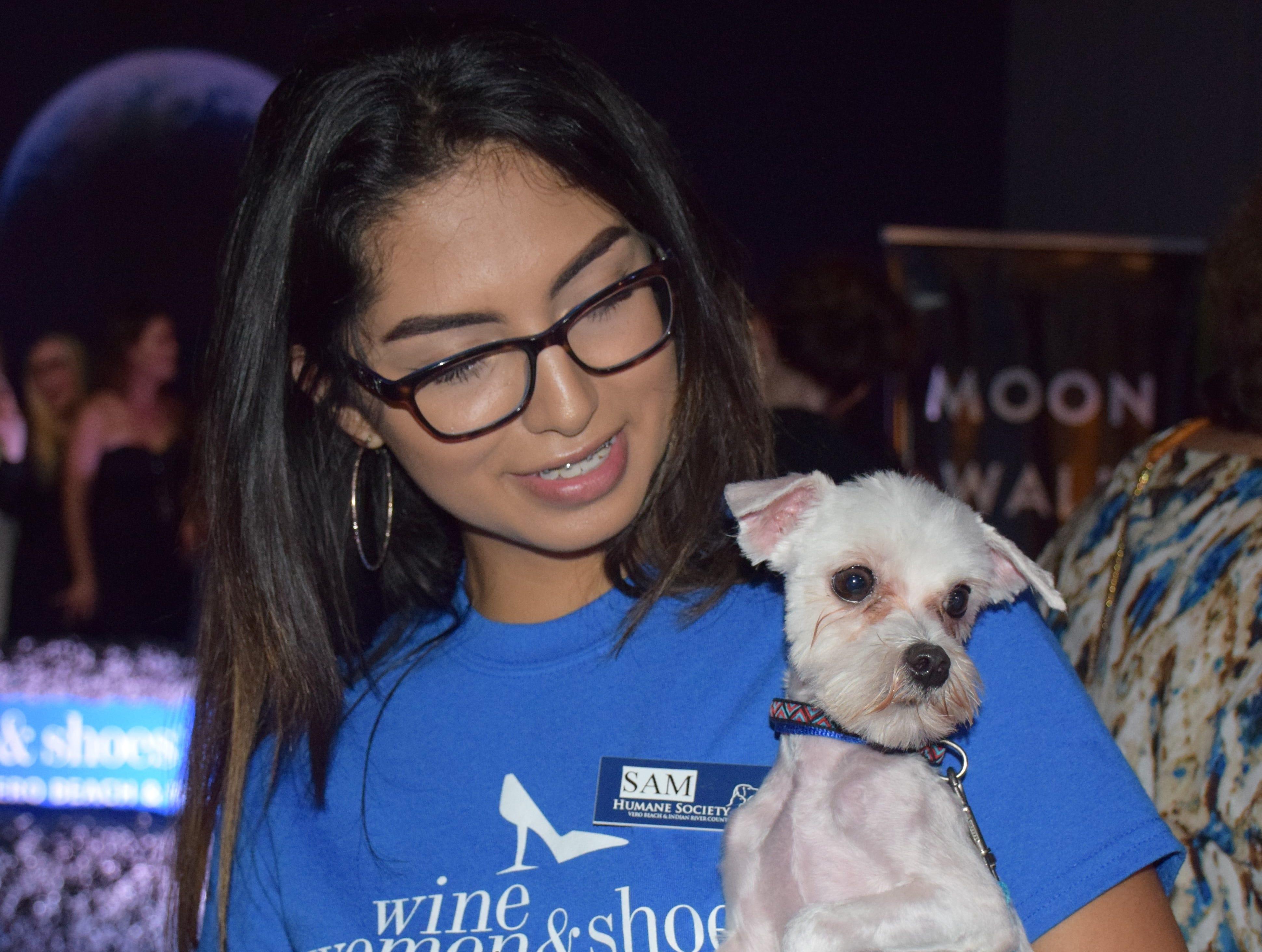 Samantha Sanchez holding rescue dog Buddy.