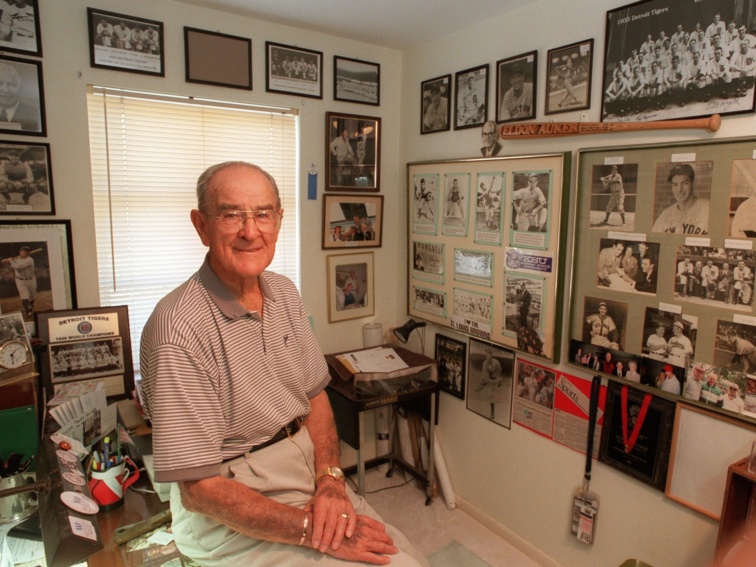 July 5, 2002 - Elden Auker, a Vero Beach resident who pitched in Major League Baseball from 1933-42, sits at home surrounded by pictures of family and baseball. Auker, who moved to Vero Beach in 1974, was the last living ex-player to have pitched to Babe Ruth. Auker passed away in 2006.