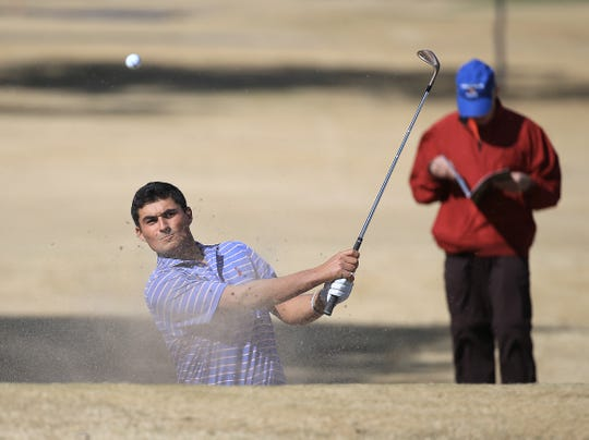 Clemson's Bryson Nimmer chips out of the sand Tuesday in the Sun Bowl Marathon All-America Golf Classic on Tuesday at the El Paso Country Club.