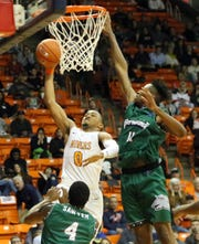 UTEP freshman guard Nigel Hawkins drives for a layup against Eastern New Mexico Monday night.