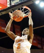 Jordan Lathon, 2, of UTEP gets a slam dunk against Eastern New Mexico Monday night.