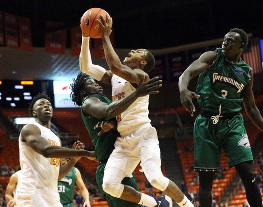 UTEP's Evan Gilyard, 3, drives for a shot under heavy pressure from Eastern New Mexico, including Mangistu Jongkor, right, earlier this season in the Don Haskins Center. Gilyard has announced he is transferring from UTEP after two years with the program.