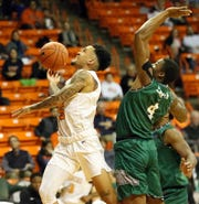 UTEP's Kobe Magee, 15, beats Darius Sawyer of Eastern New Mexico to the basket during the recently completed season. Magee has announced he is transferring from UTEP.
