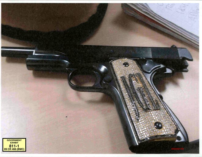 """This undated photo provided by the U.S. Attorney's Office shows a diamond-encrusted pistol that a government witness said belonged to infamous Mexican drug lord Joaquin """"El Chapo"""" Guzman, at Guzman's trial in New York, Monday, Nov. 19, 2018. Jurors were shown a photo of the pistol decorated with Guzman's initials as witness Jesus Zambada told how Guzman relied on rampant bloodshed and bribery to protect his multibillion-dollar drug smuggling operation and the brutal way Guzman's Sinaloa cartel dealt with various violent threats and personal slights."""