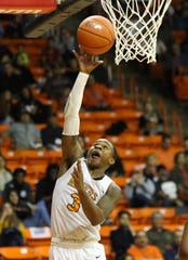 UTEP's Evan Gilyard, 3, goes up for a shot Monday night.