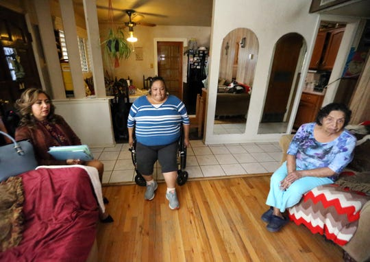 Elizabeth Silva, left, of the Area Agency on Aging visits Margarita Ryon, center, and Ryon's mother, Marina Sotelo in their Lower Valley home.