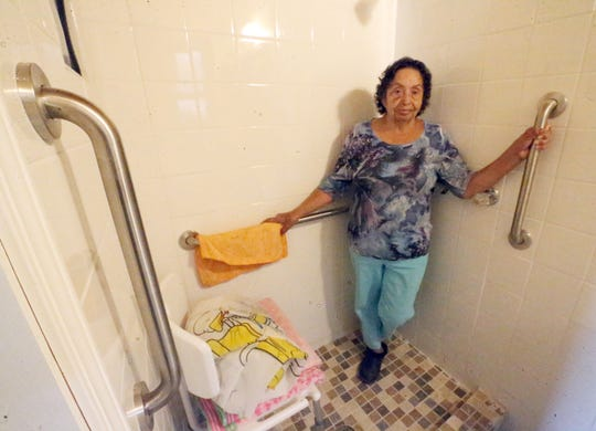 Marina Sotelo inside the remodeled master bathroom shower with hand bars. Her husband, Juan Sotelo was in a rehabilitation facility recovering from a heart attack and was due to be released soon.