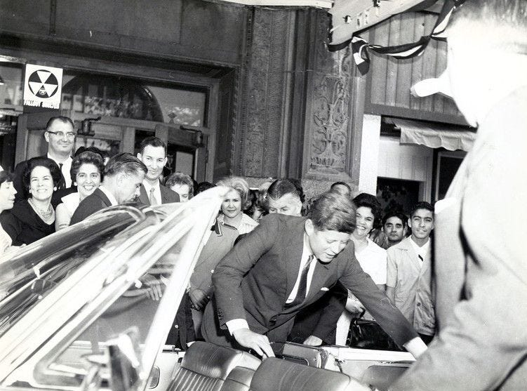 06/07/1963 READY TO LEAVE - President Kennedy boards his special limousine in front of Hotel Cortez Thursday morning after shaking hands with several of the thousands of persons who gathered to say goodbye to the first chief executive to visit El Paso since 1948.