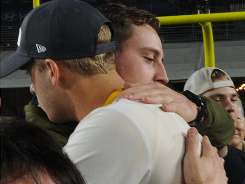 Rams quarterback Jared Goff, left, hugs hugs Jordan Helus, son of Ventura County Sheriff's Sgt. Ron Helus, after Monday night's game against the Chiefs. Sgt. Helus was killed during the Borderline Bar & Grill shooting.