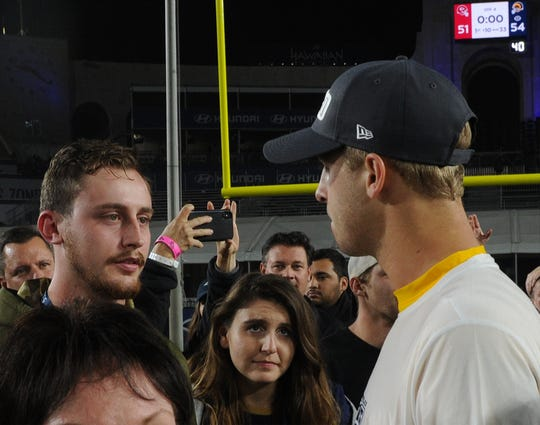 Jared Goff, right, meets with Jordan Helus, son of Ventura County Sheriff's Sgt. Ron Helus, who was killed at the Borderline Bar and Grill, after the Rams – Chiefs game Monday night.