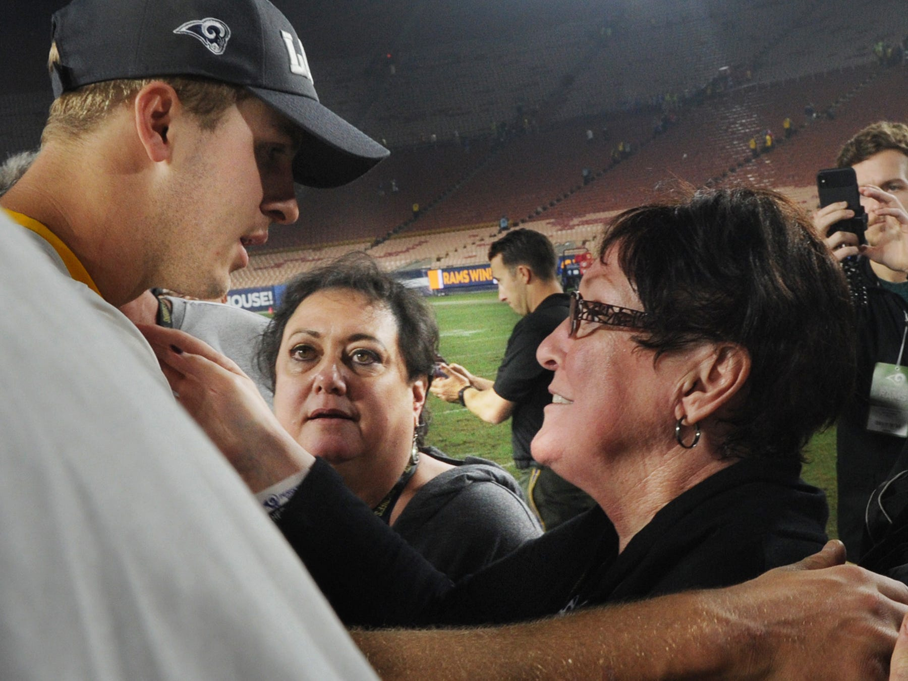 Los Angeles Rams quarterback Jared Goff, talks with Karen Helus, center, wife of Ventura County Sheriff's Department Sgt. Ron Helus, and Pam Archie, right, Karen's mother, after Monday night's game against the Kansas City Chiefs at the Coliseum. Sgt. Helus was killed in the Borderline Bar & Grill shooting. The Rams honored the family of the victims and also the first responders to the shooting and recent wildfires.