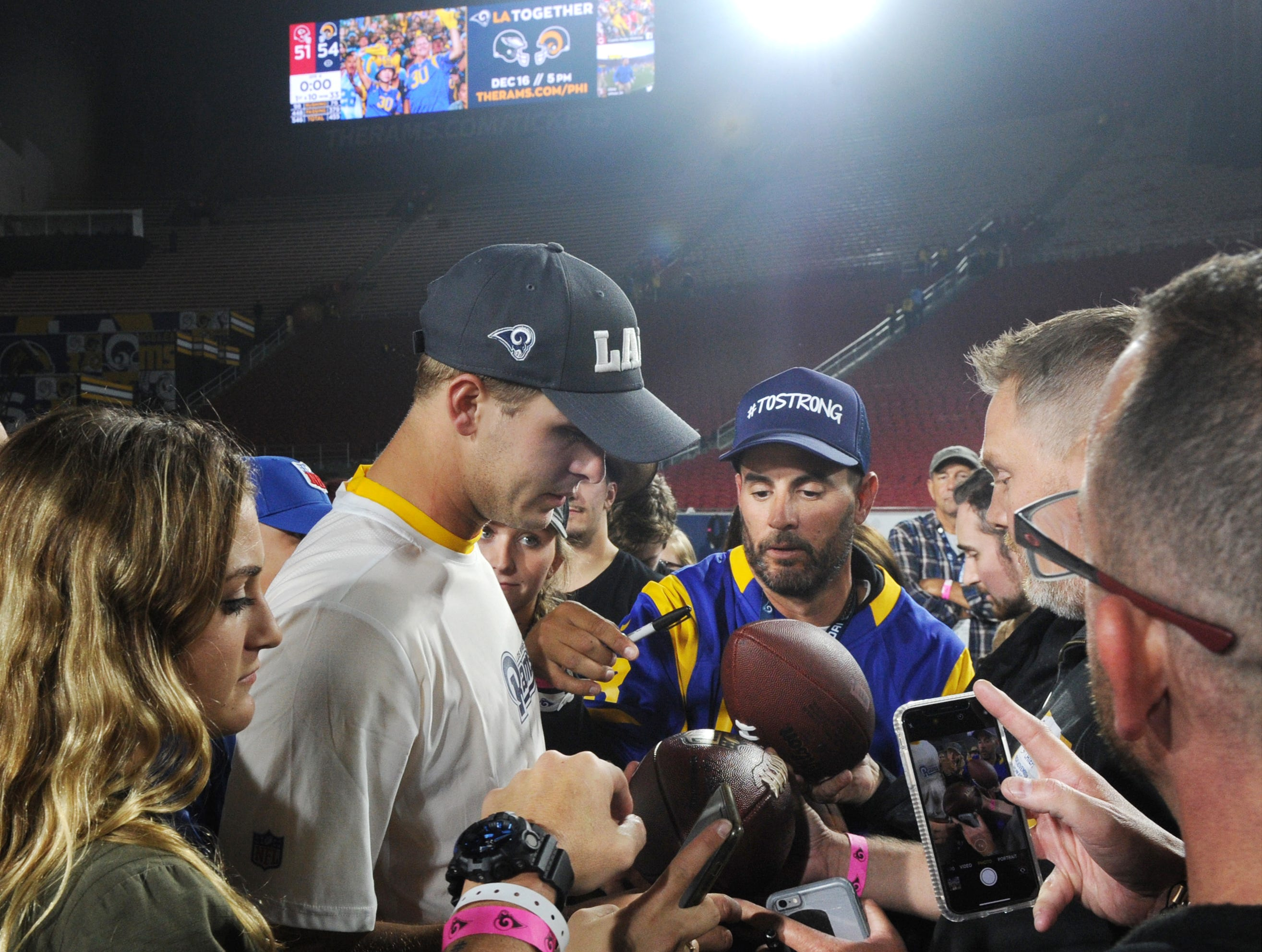 Quarterback Jared Goff signs autographs for first responders after the Rams' 54-51 win over the Chiefs on Monday night.