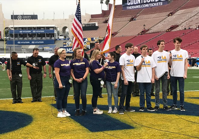 Members of the Cal Lutheran University choir and the Ventura County Sheriff's Honor Guard prepare for their national anthem performance before the Rams' win over Kansas City on Monday night. Borderline Bar & Grill shooting victim Justin Meek was a former soloist with the choir and men's quartet.