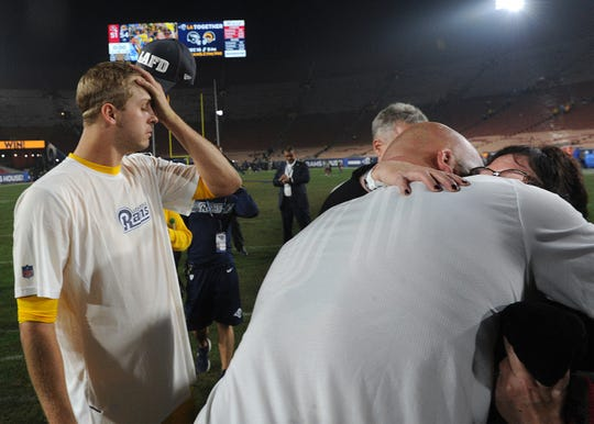 Rams offensive tackle Andrew Whitworth, right, hugs Pam Archie, mother-in-law of Ventura County Sheriff's Department Sgt. Ron Helus, after the Monday night's game against the Chiefs. At left is Rams quarterback Jared Goff. Sgt. Helus was killed in the Borderline Bar & Grill shooting.