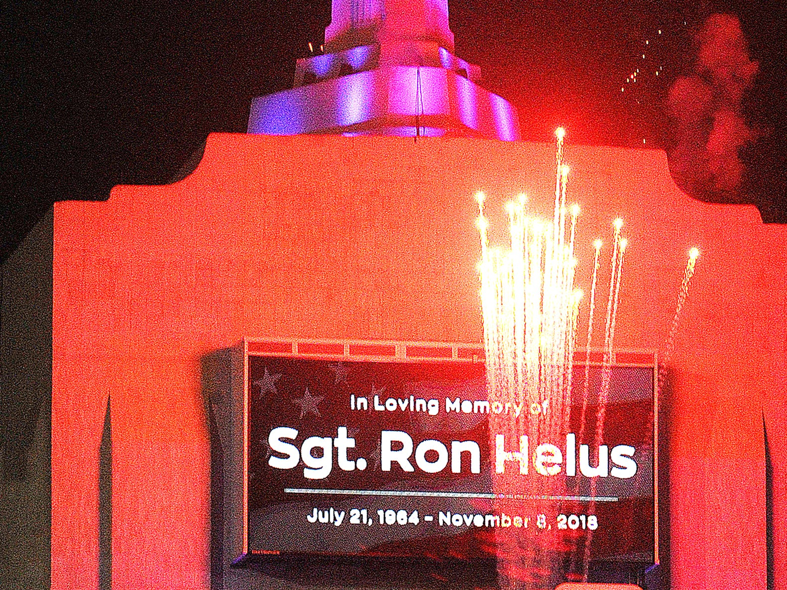 The Coliseum torch is lit in honor of Ventura County Sheriff's Department Sgt. Ron Helu before Monday night's game against the Chiefs. Sgt. Helus was killed in the Borderline Bar & Grill shooting.