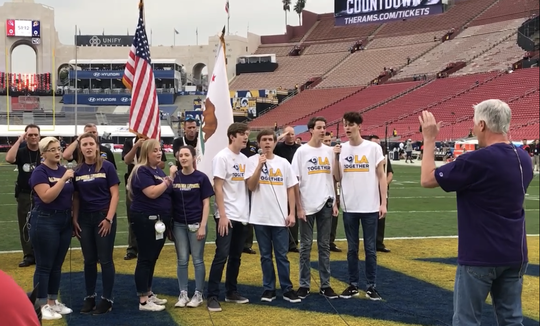 Members of the Cal Lutheran University choir, Katie Shearer (left to right), Maddy Barnes, Nissa Rolf, Lauren Curl, Dylan Brine, Paul Kellogg, Anthony Morgan and Jordan Erickson, directed by Dr. Wyant Morton, perform their sound check at the Coliseum on Monday afternoon. The students performed the national anthem before the Rams' win over Kansas City.